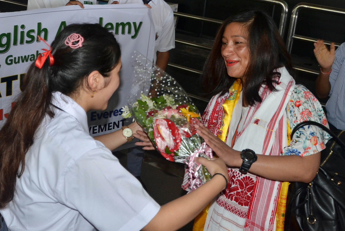 Anshu Jamsenpa (age 37), is being welcomed by school students at her arrival at Lokapriya Gopinath Bordoloi International