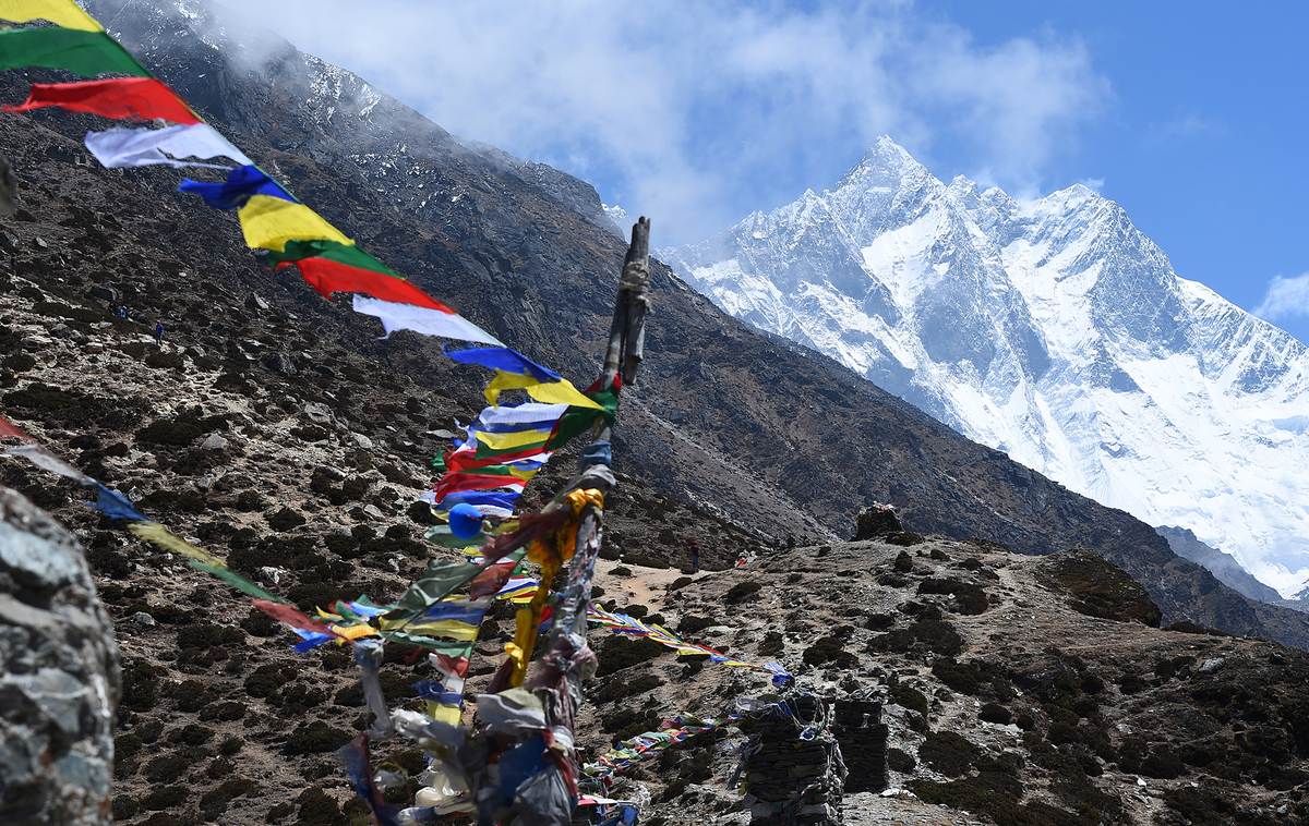 Trekkers walk along a path at the Everest region