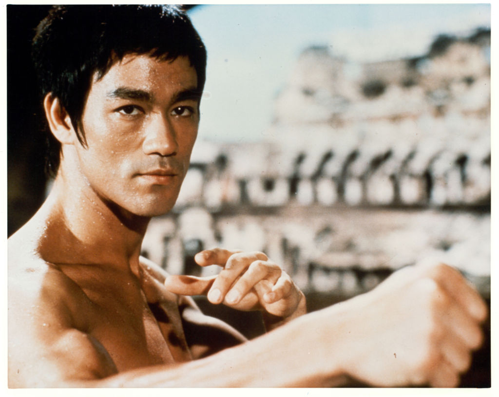 Bruce Lee in a martial arts position in a scene from the film 'Enter The Dragon'-159816248