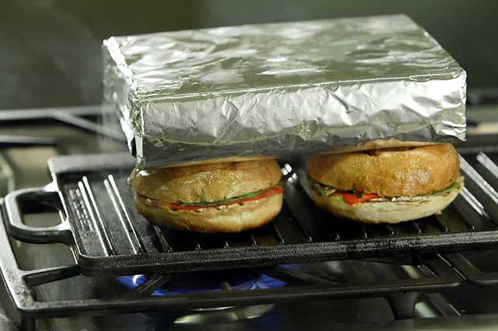 Brick wrapped in foil on top of sandwiches