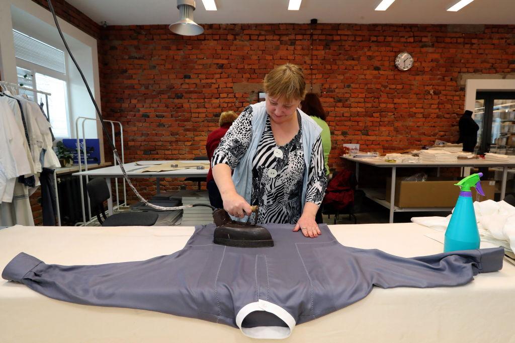 Woman ironing shirt