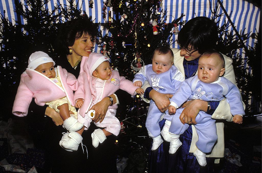 two women with their twins