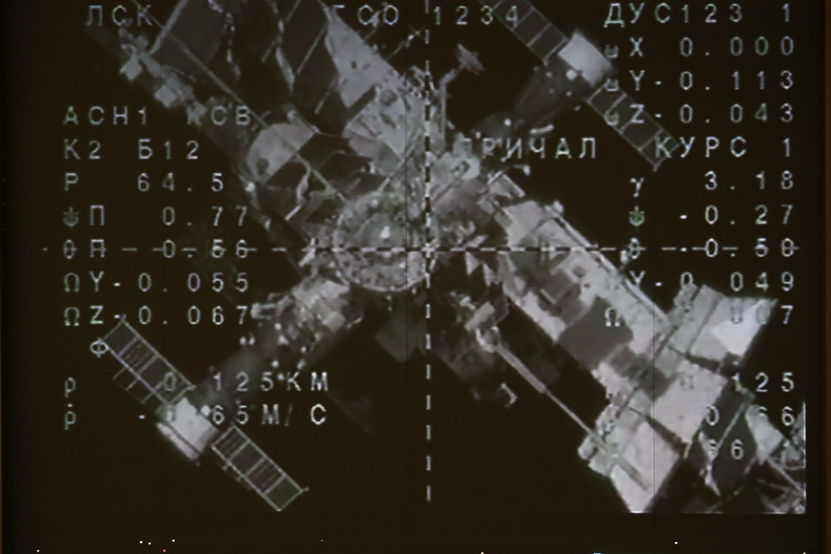A screen broadcasting the redocking of the Soyuz MS-14 spacecraft