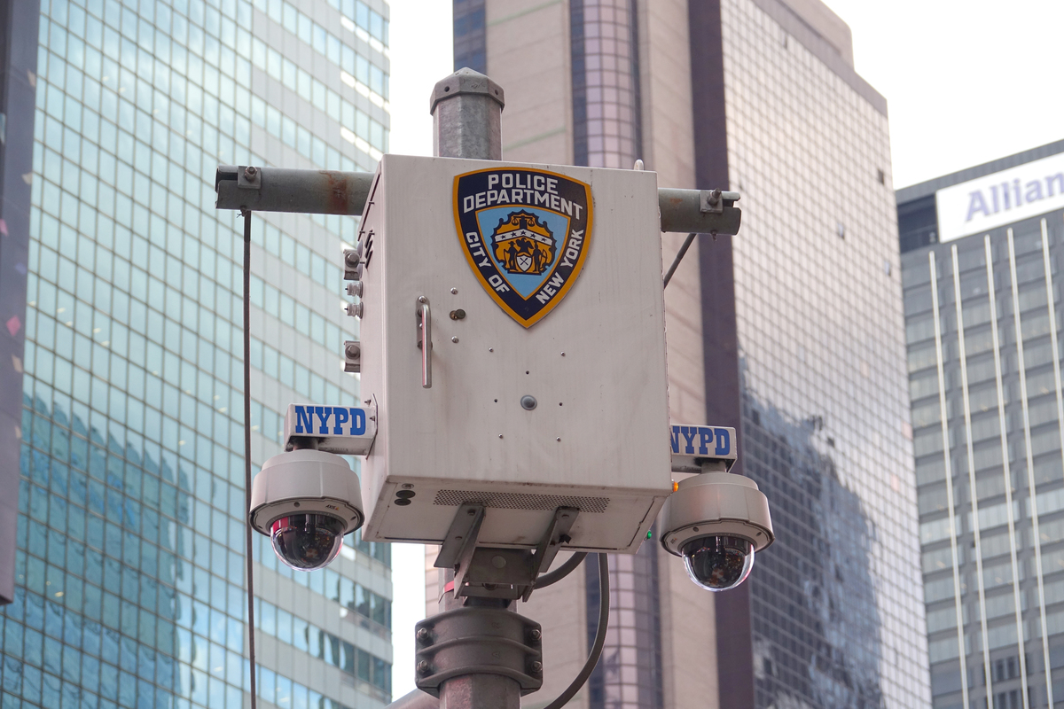 The logo of the New York City Police Department (NYPD) stands on a surveillance camera near Times Square.