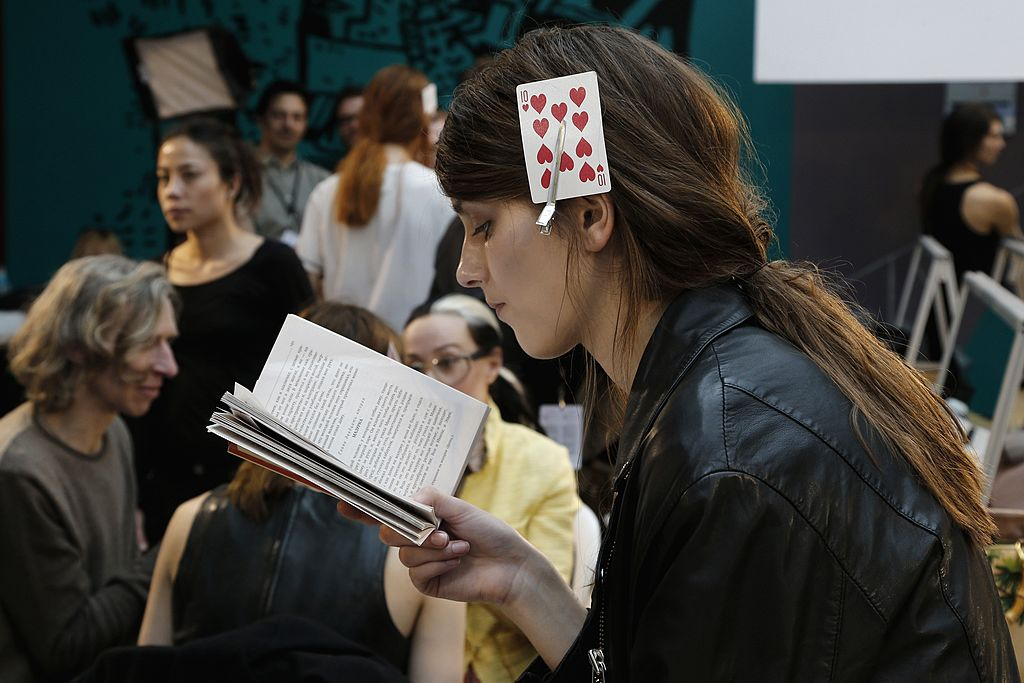 a french woman with a playing card in he hair
