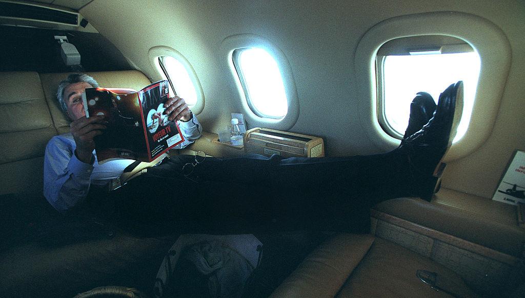 Leno reads on a plane