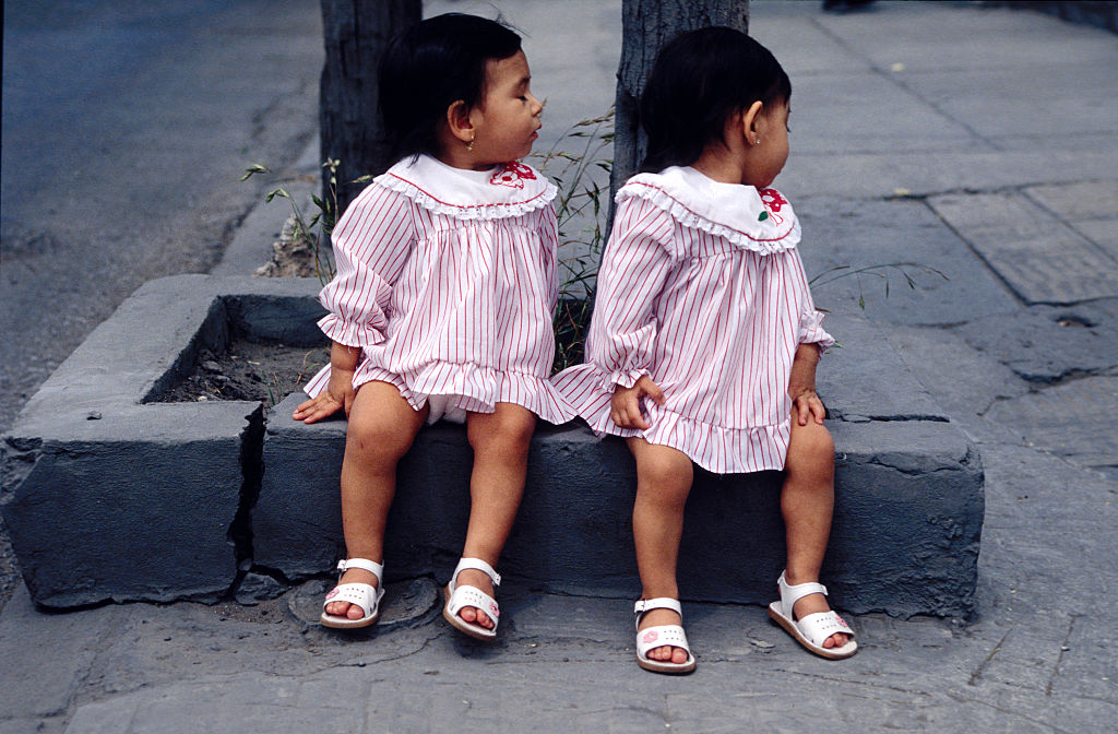 twin girls in matching dresses