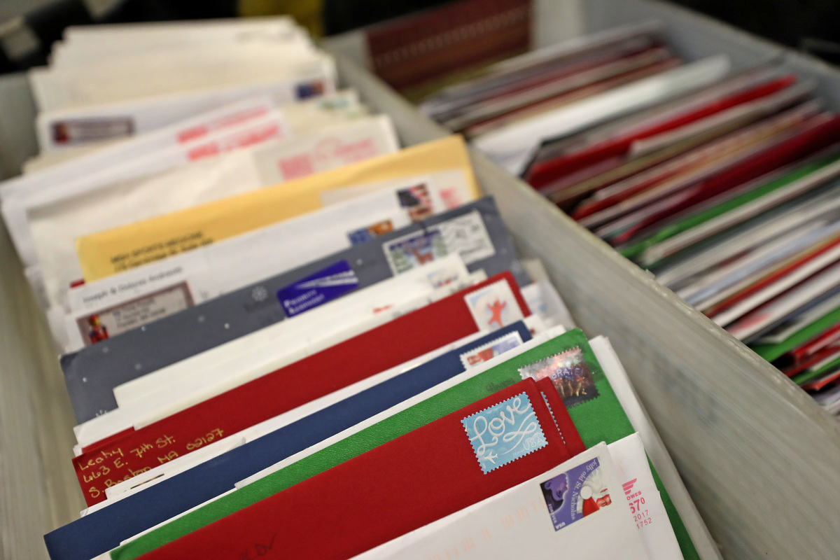 Cards in bins are ready to process at a United States Postal Service facility.
