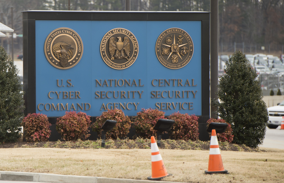 A sign for the National Security Agency, US Cyber Command and Central Security Service, is seen near the visitor's entrance to the headquarters of the NSA.