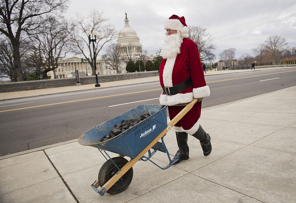 Man dressed as Santa Claus with coal