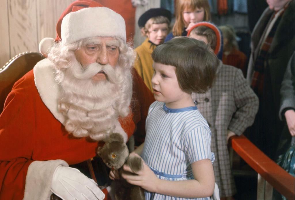 Little girl talking to Santa