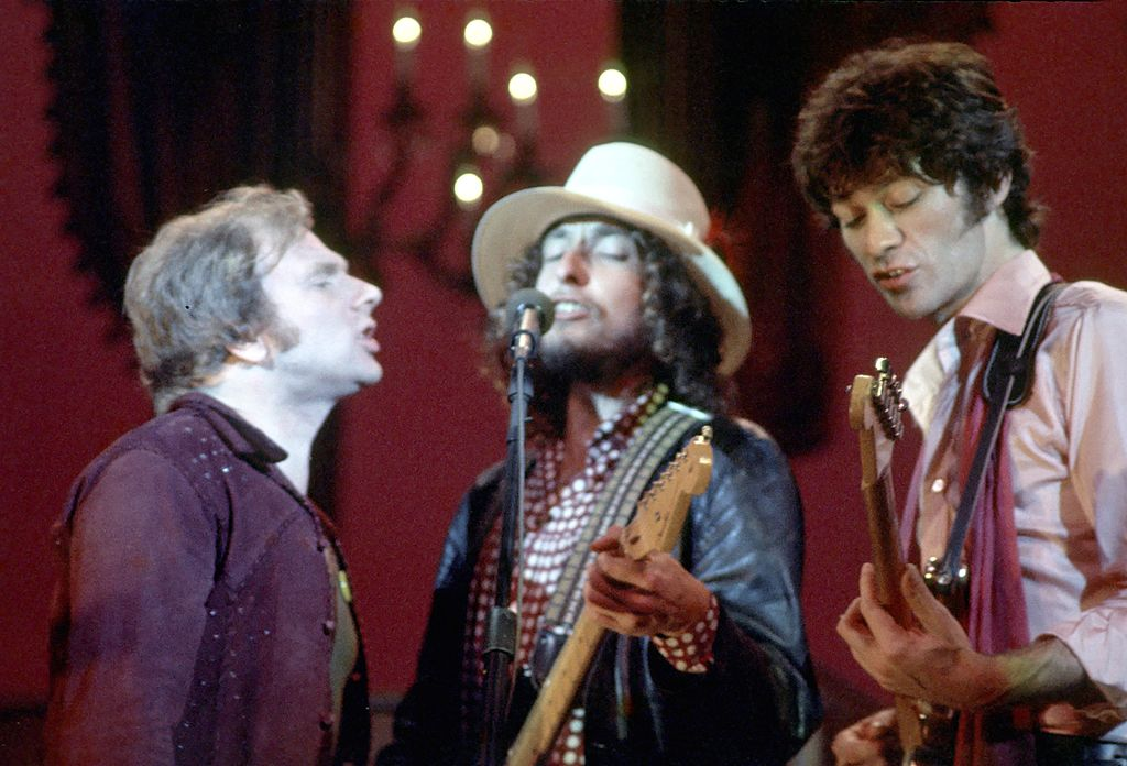 Van Morrison, Bob Dylan and Robbie Robertson performing on stage