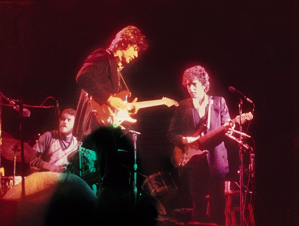 (L-R) Levon Helm, Robbie Robertson and Bob Dylan performing on stage