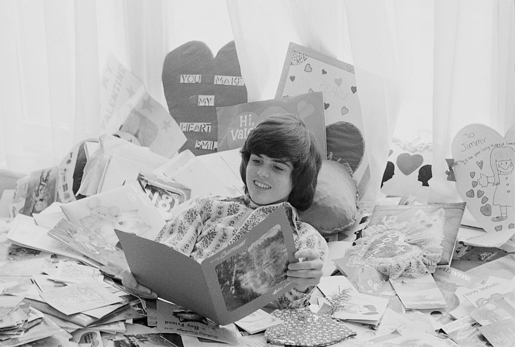 Young Donny Osmond lays in a pile of Valentine's Day cards.