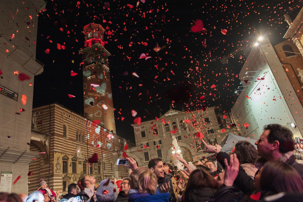 A crowd throws paper hearts in the air in Verona, Italy.