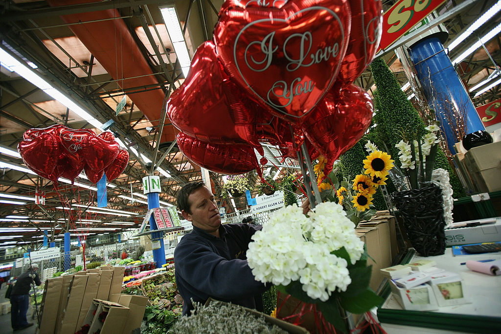 A store worker sets up Valentine's Day gifts.