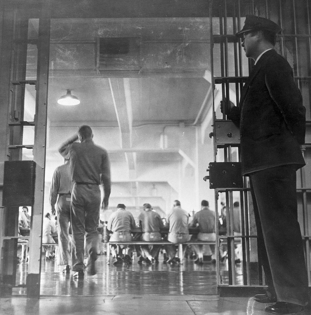 A guard stands by as prisoners enter the Alcatraz mess hall for supper.