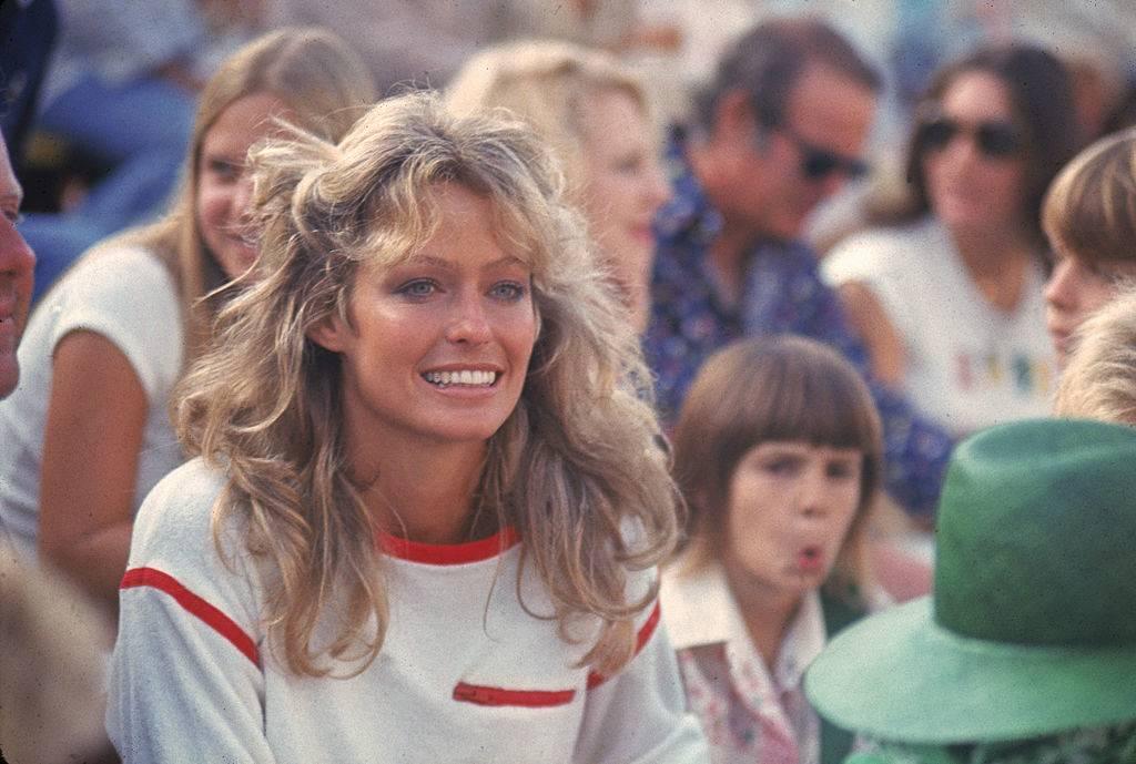 Fawcett at a tennis match