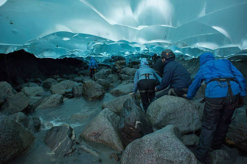 People under a glacier