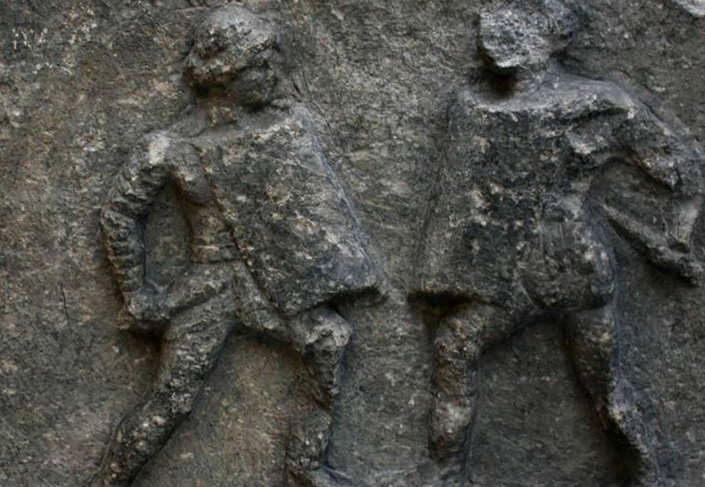Relief of two men fighting