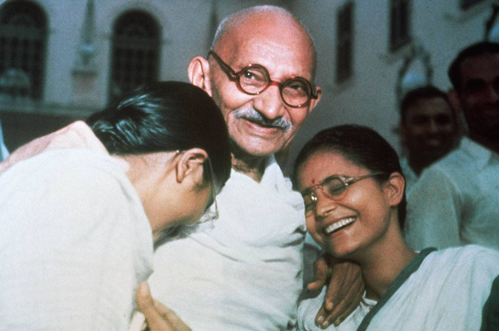 gandhi laughing with his granddaughters