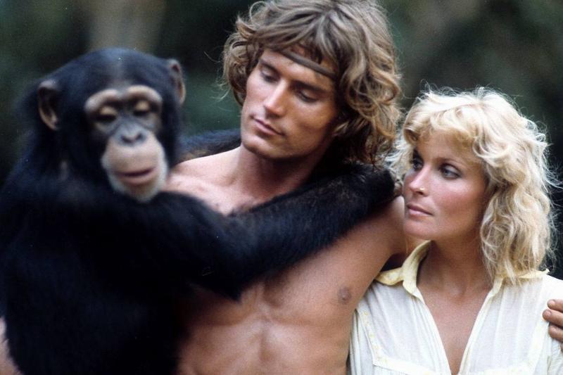 miles o'keefe, bo derek, and a monkey in a scene from tarzan, the ape man