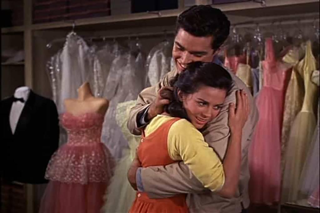 Tony and Maria hugging