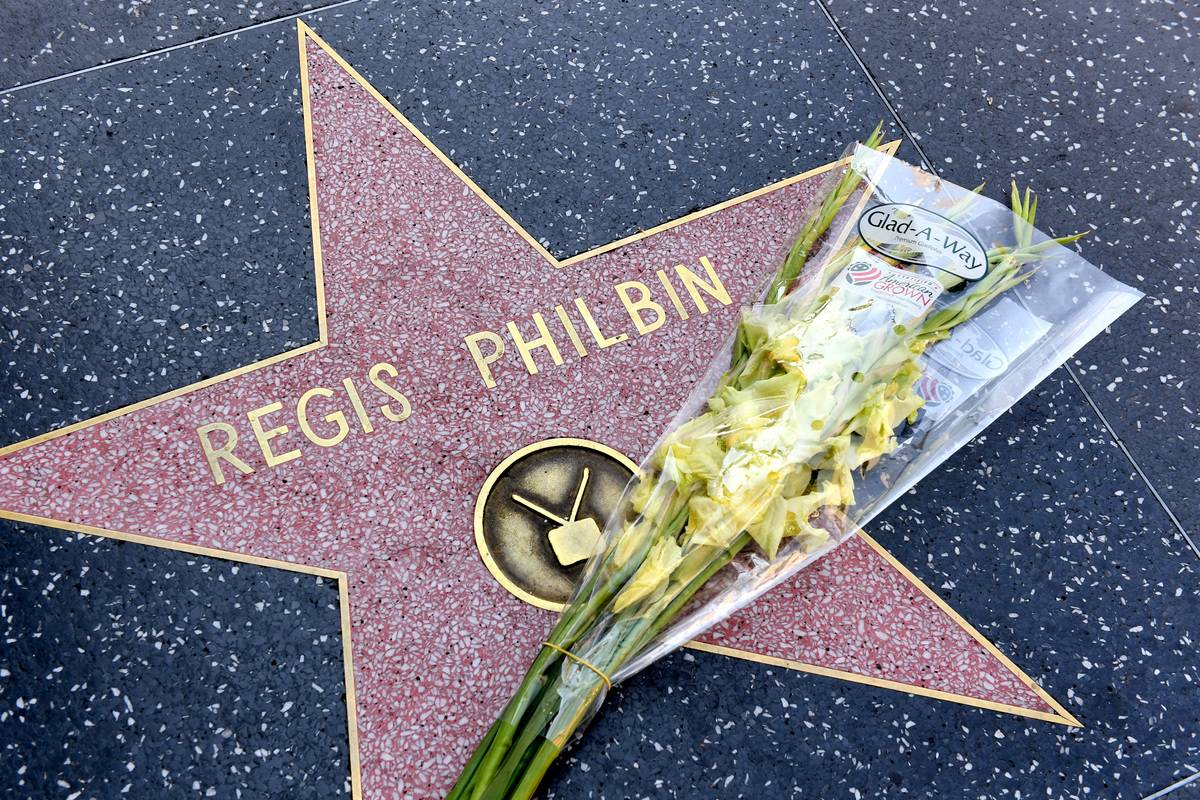 Flowers are placed on television host Regis Philbin's star on the Hollywood Walk of Fame.