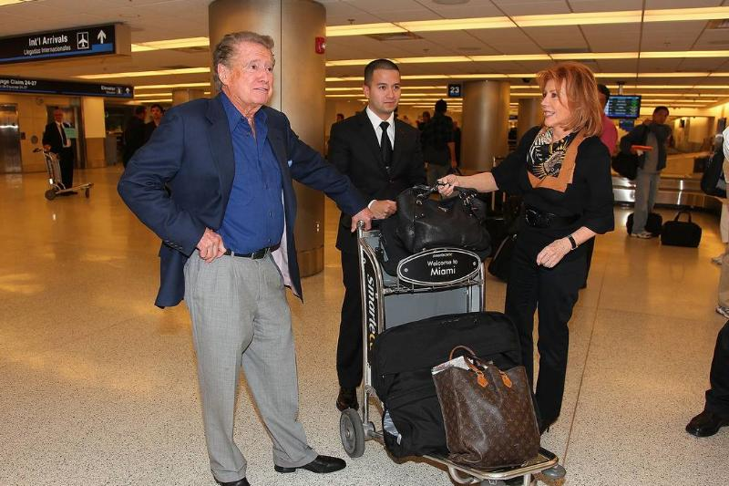 Regis Philbin and his wife Joy are seen at the Miami International Airport.