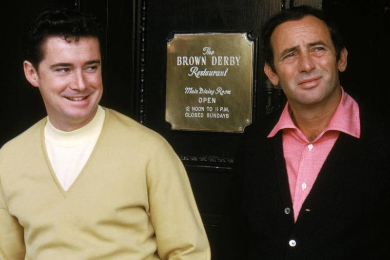 Regis Philbin and Joey Bishop stand outside the famous Brown Derby Restaurant.