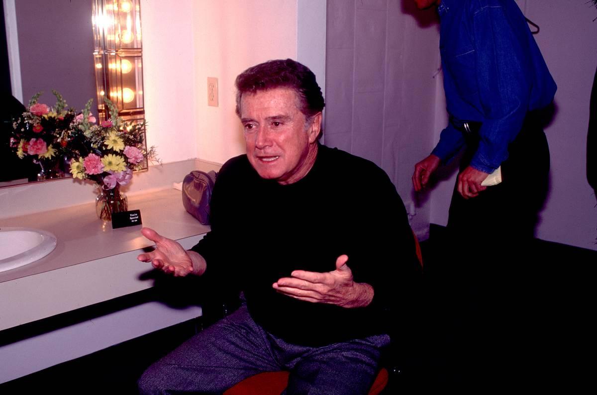 Regis Philbin sits backstage.