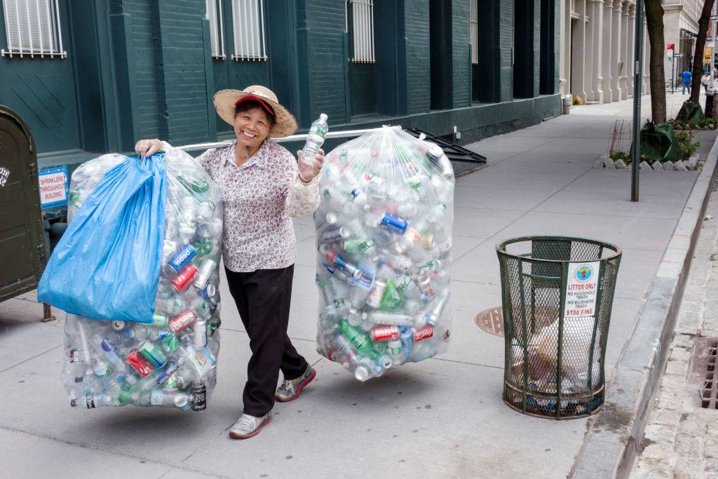A woman with bags of recycling aluminum cans.