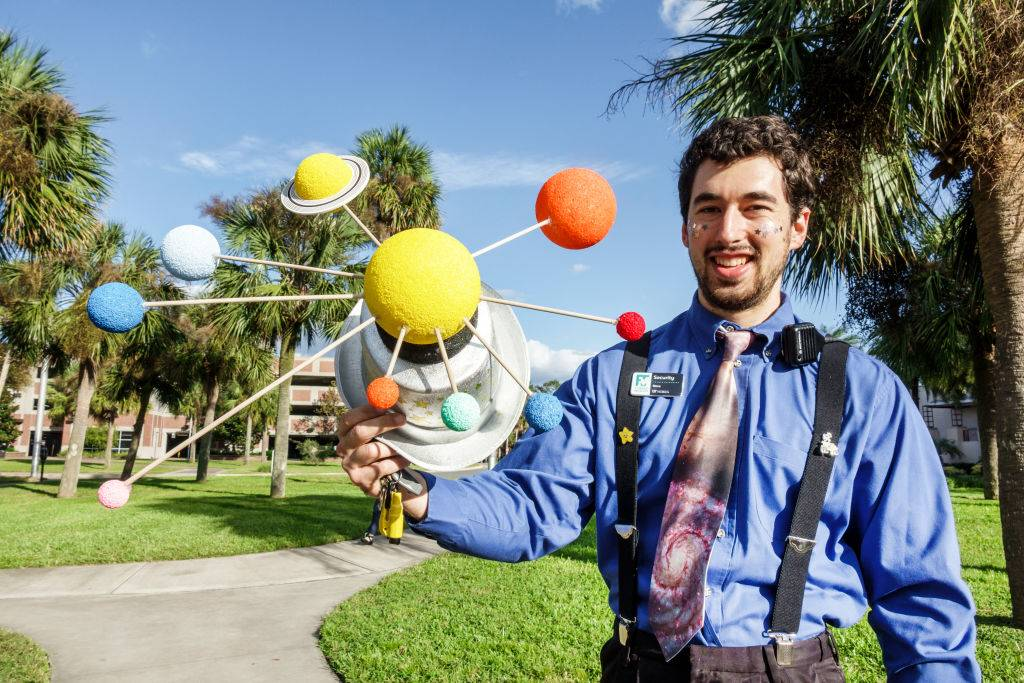 University of Florida Museum of Natural History, man holding Solar System model