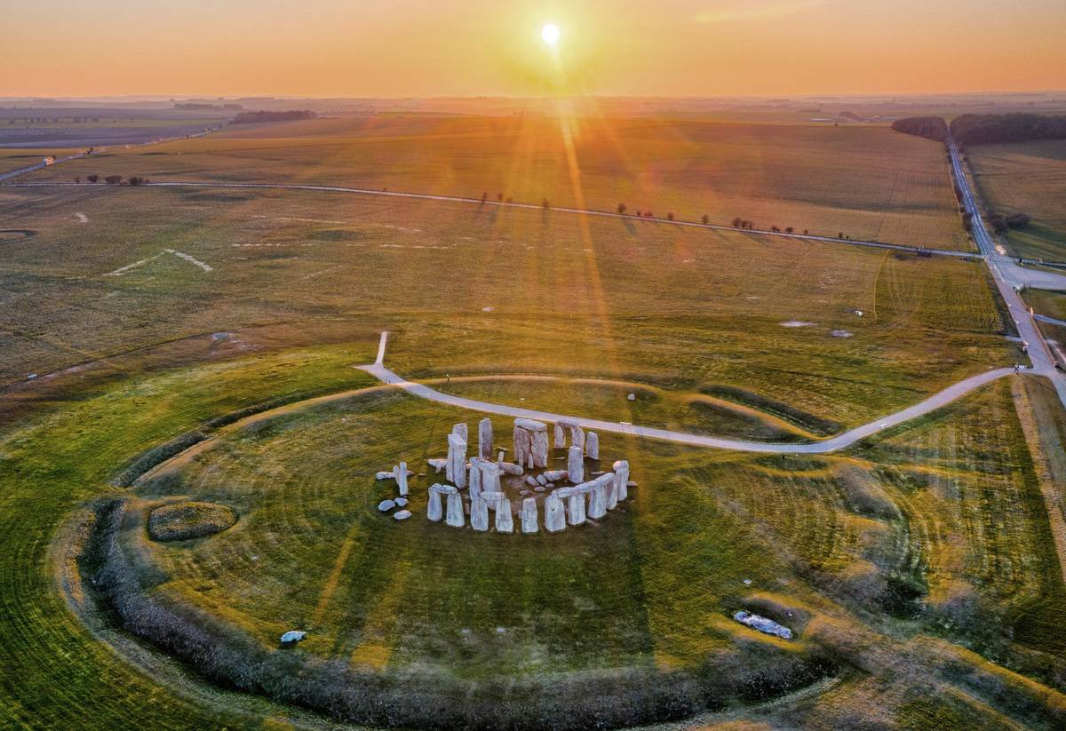 An aerial view shoes Stonehenge at sunset.