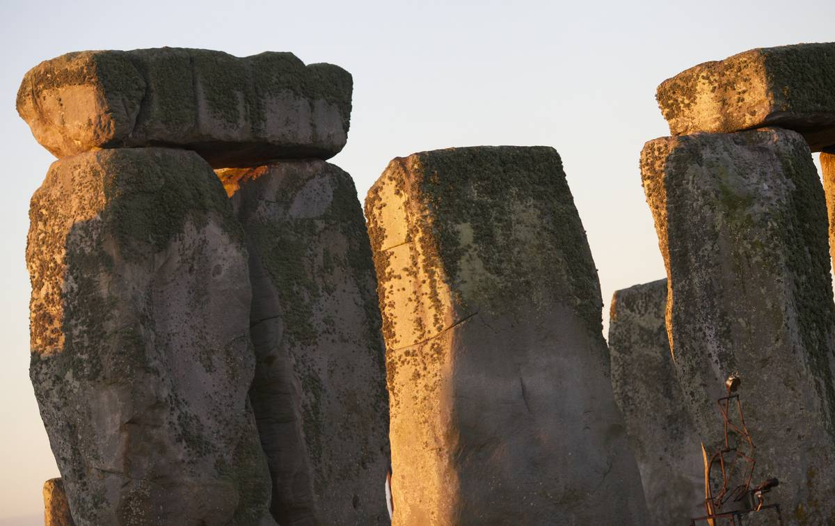 A close-up photo shows the sarsen stones of Stonehenge.