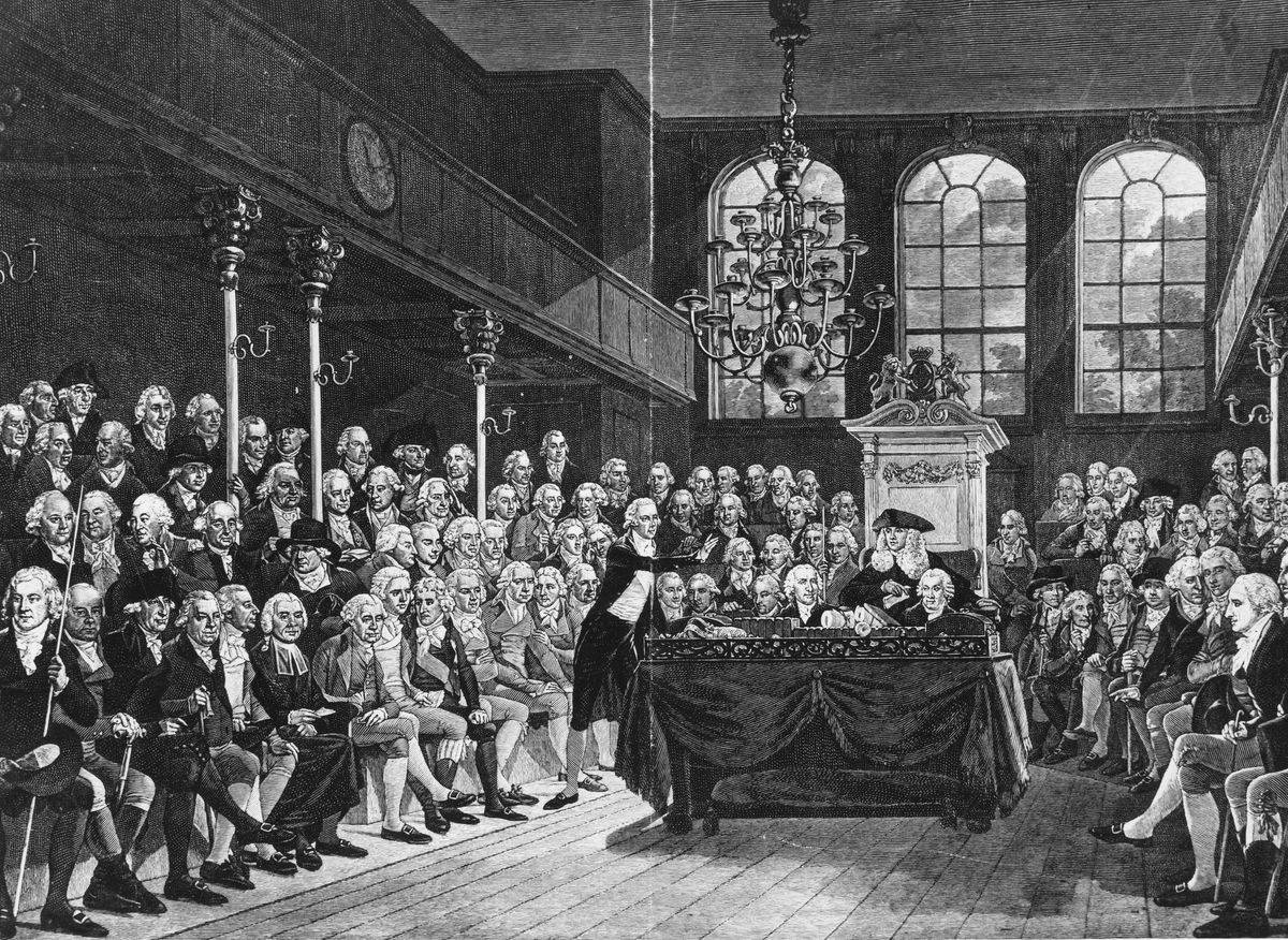 An illustration shows the British Prime Minister speaking to Parliament in the 18th century.