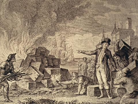 An illustration shows the Sons of Liberty burning boxes of tea.