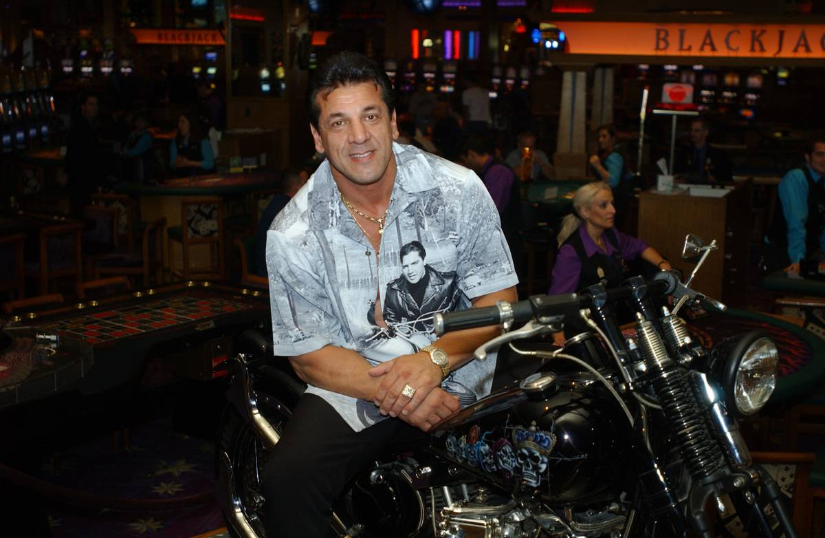 Chuck Zito sits on a motorcycle ing The Hard Rock Hotel and Casino.