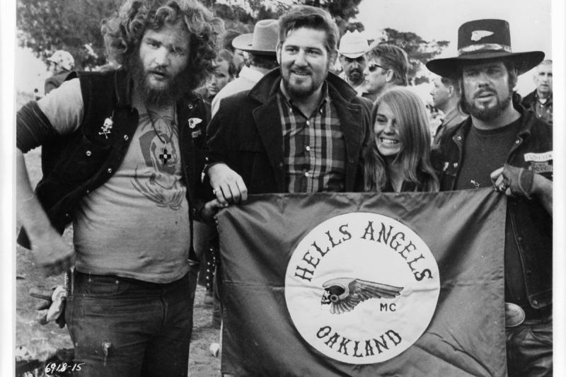 Hells Angels from Oakland hold up a flag in 1969.