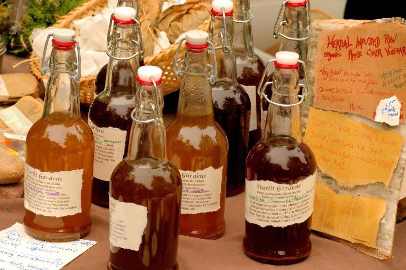 Varieties of apple cider vinegar are in glass bottles.