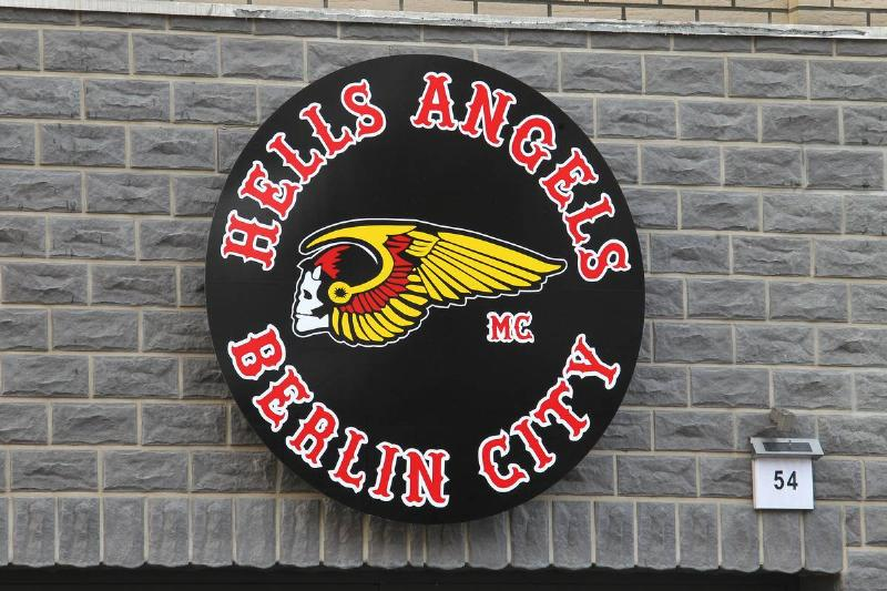 A sign for the Hells Angels Berlin chapter is on a building.