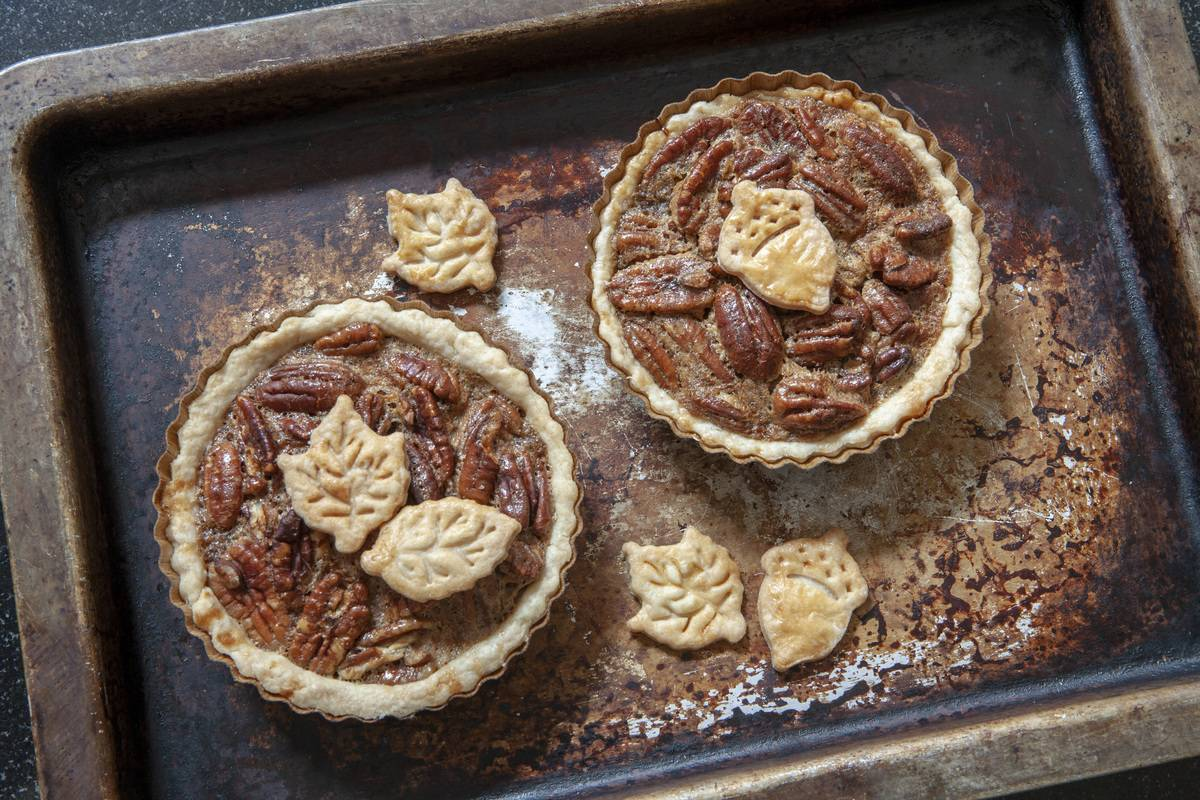 Two Mini Pecan Pies on Baking Sheet, High Angle View