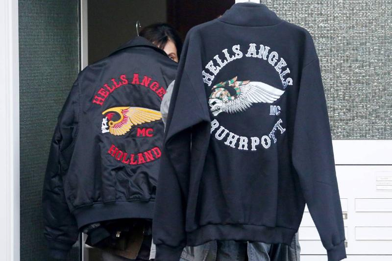 Hells Angels jackets hang outside to dry.