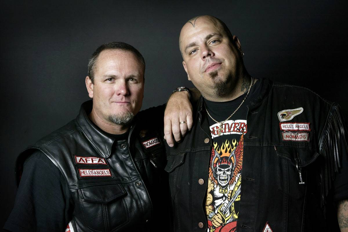 Two Hells Angels members pose for a photo together.