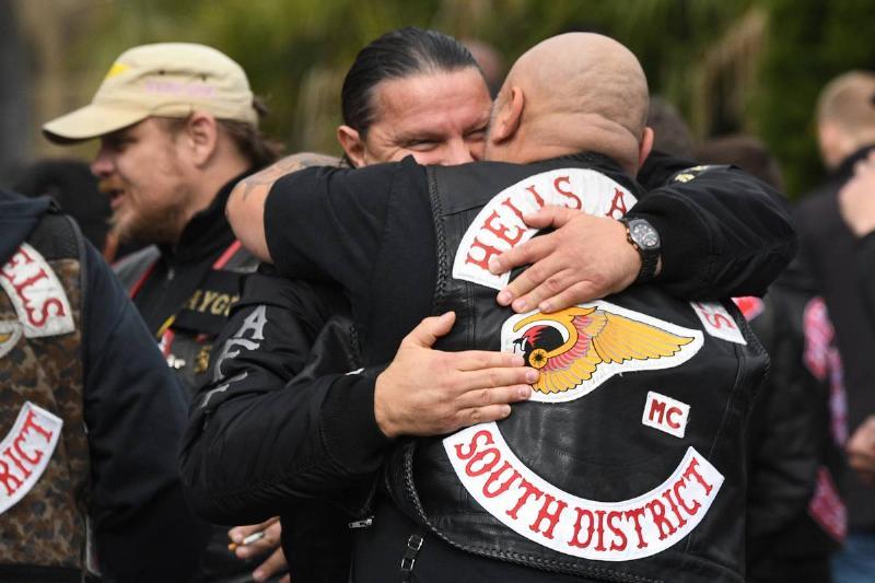 Two Hells Angels members hug each other.