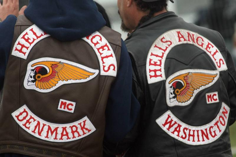 The Hells Angels logo and insignia are seen on the back of members' vests.