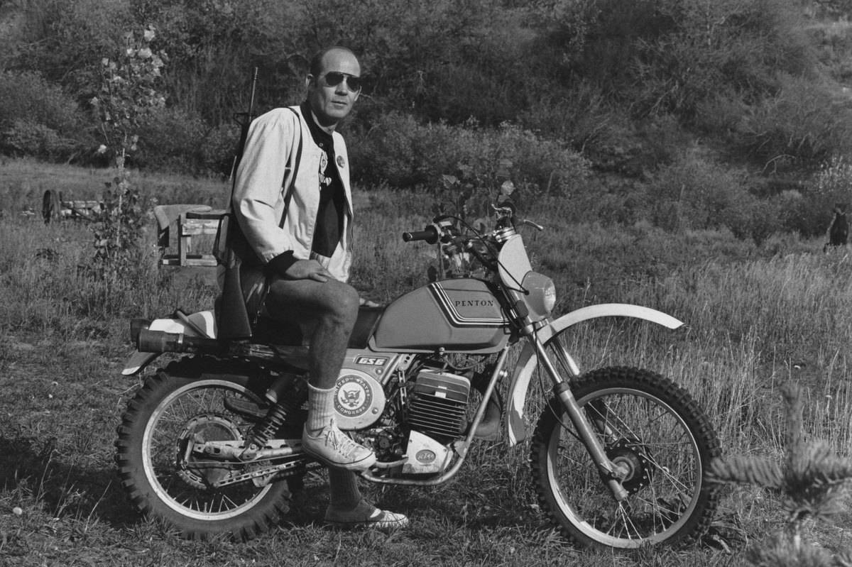Journalist Hunter S. Thompson sits on his Penton Motor Cycle.