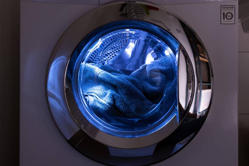 Towels are seen in a washing machine.