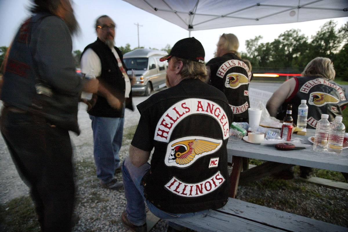 Hells Angels eat outside and talk.