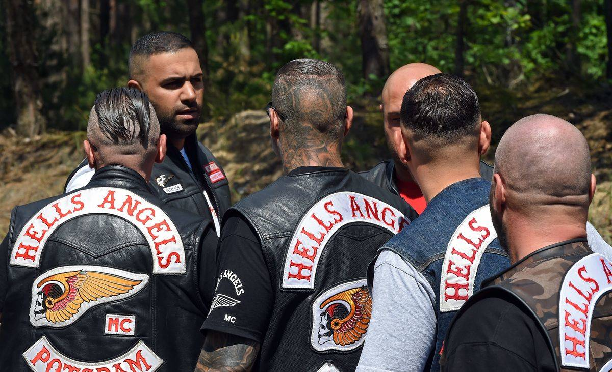 A group of Hells Angels gather and talk.